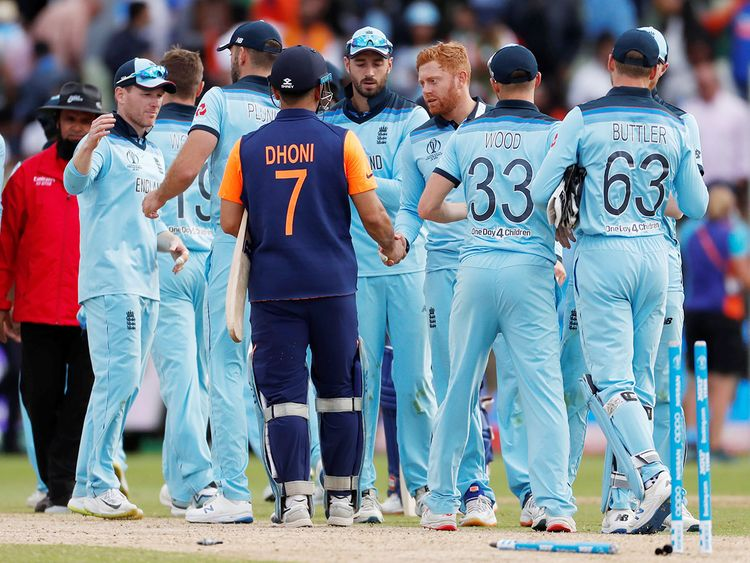 English Team shaking hands with Dhoni After Winning