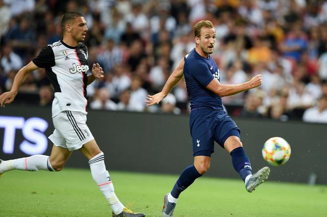 Footballer Kicks Football